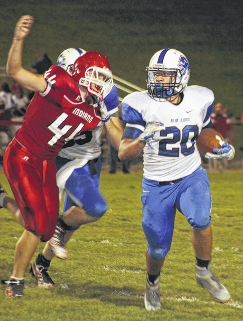 Kyle Garrett (20) carries for the Washington Blue Lions during an SCOL game at Hillsboro Friday, Sept. 18, 2015.