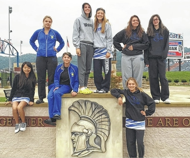 The Washington Lady Blue Lion tennis team members are pictured in Portsmouth at the Sectional tournament. (standing at right), Jen Richards; (seated, l-r); Yui Kobayashi and Megan Downing; (standing in back, l-r); Sierra Dawson, Maria Pickerill, Anna Nestor, Mackenzie Cress and Camryn Waldrop.