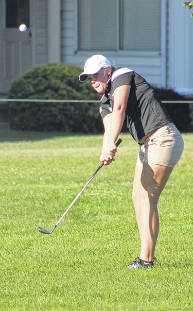 Miami Trace junior Lindsey Worley chips onto the No. 8 green at the Club at Quail Run during an SCOL match against McClain Monday, Sept. 21, 2015.