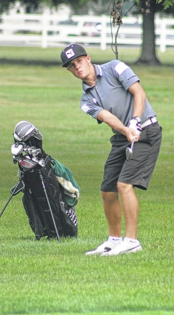 Miami Trace's Mitchell Creamer chips onto the green during an SCOL match against East Clinton Wednesday, Sept. 2, 2015 at the Club at Quail Run.
