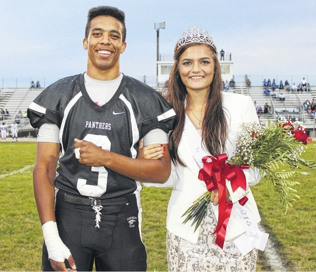 """During pre-game against Chillicothe Friday, Miami Trace High School honored their 2015 Homecoming Court by presenting them to the fans. Larry Jackson and Morgan Ford were named the king and queen. The high school will hold their dance this evening with the theme """"Midnight Masquerade."""" Please see today's sports and the Friday Night Lights page for more Homecoming coverage."""