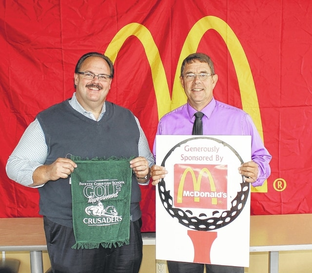 Nick Epifano, above, left, owner and operator of McDonald's of Fayette County and Jamestown, is joined by Pastor Tony Garren to announce the sixth annual Fayette Christian School golf tournament, to be held Saturday, Sept. 26 at Buckeye Hills Golf Course near Greenfield.