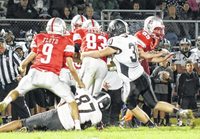 Miami Trace junior Lance Mick (30) makes the tackle of East Clinton's Brian Barnes during an SCOL game at Lees Creek Friday, Oct. 9, 2015. Also pictured for the Panthers is Tiante Connell (87).