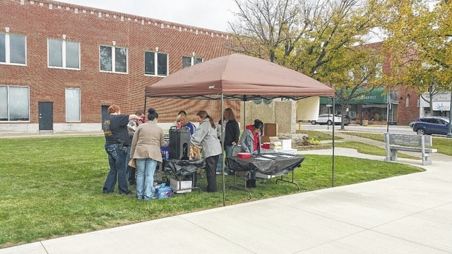 "Employees of the Fayette County Courthouse in Washington C.H. held a ""Tailgate Party"" Friday on the Courthouse lawn. All proceeds from the event will go to support United Way."