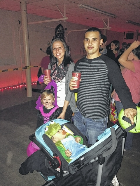 Nic Hargo, Danielle Camp, Lila Camp, and Corlan Hargo prepared themselves for the candy and spooky that Boonanza offered Fayette County residents Thursday night at the Mahan Building.