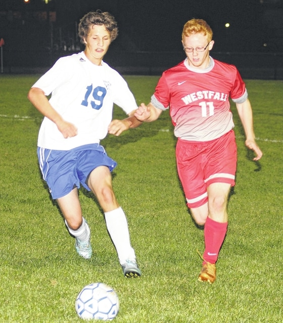 Jakob Snyder, at left, for Washington, races a Westfall player to the ball during a non-league match at Washington High School Tuesday, Oct. 13, 2015.