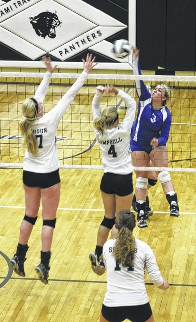 Jaycie McRoberts (3) hits the ball for Washington during an SCOL match at Miami Trace High School Thursday, Oct. 8, 2015. Pictured for Miami Trace are (l-r); Samantha Ritenour, Ashley Campbell (4) and Clare Sollars (14).