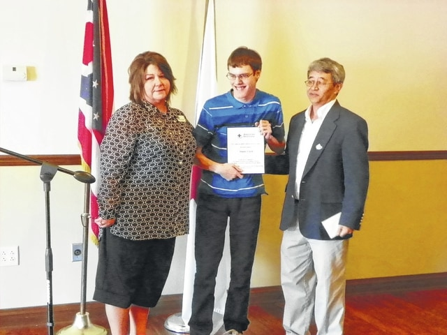 Jimmy Clark, a 16-year old Fayette County resident, was honored as the Youth Hometown Hero during the Fayette County Hometown Heroes celebration Monday afternoon at the Crown Room. He is pictured with Katie Bottorff, with Red Cross and Rod Cook, executive director for the Red Cross, serving Fayette, Knox, Fairfield, Hocking, Pickaway and Ross counties.