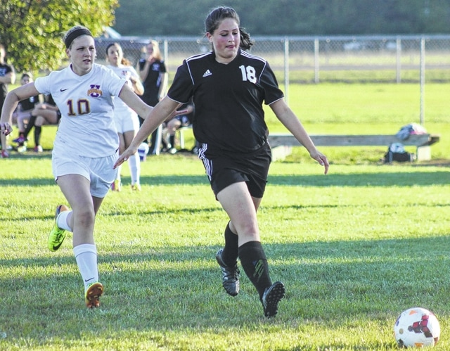 Miami Trace's Jordan Bernard, above, right, races a Unioto player to the ball during a Division II Sectional tournament game at Unioto High School Tuesday, Oct. 20, 2015.
