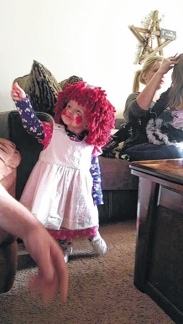 Landon Maiden lit up Beggar's Night dressed as Raggedy Ann on Thursday.