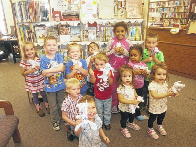 "A Paw Patrol Party, hosted by Miz Bonnie of Jeffersonville Branch Library, was held recently where participants enjoyed listening to the book, ""Chase is on the Case,"" pinning the shield on Marshall, adopting their very own puppy, decorating them and putting Paw Patrol puzzles together. Participants also received scrumptious Scooby Snacks. New puppy owners are from left front: Xavier, Sebastian, Molly, Michael, Jensen, Mason, Landon, Ellia, Addie, Asia, Makenna and Darrius."