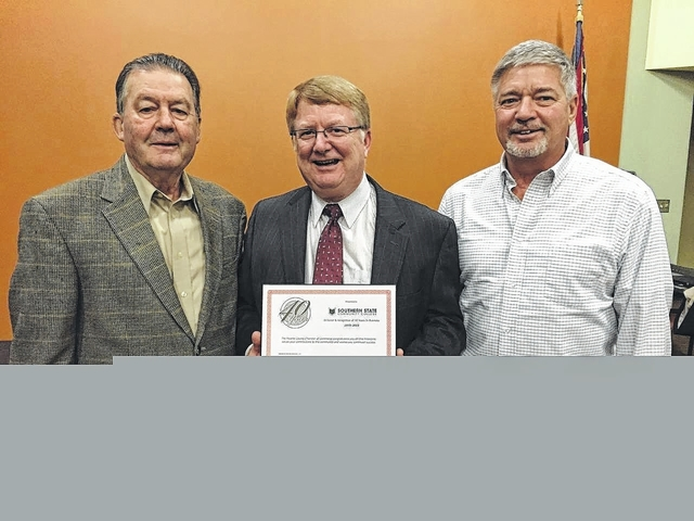 The November edition of the Fayette County Chamber of Commerce Business After Hours was held in the community room of host Southern State Community College. Southern State is celebrating its 40th anniversary and on hand to receive the recognition certificate from the chamber were (from left) former Southern State board member Jim Ward, college President Dr. Kevin Boys and current board member Doug Boedeker.