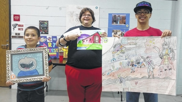 Pictured are the three top place winners of the art contest during the Oct. 22 Fayette County Provider Fair. They are Judah C. (first place), Rosie C. (third place) and Eddie H. (second place).