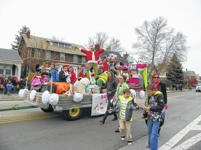 The Christmas Parade, hosted by the Fayette County Chamber of Commerce, and events during the day drew a large crowd as 80 entries entertained the community with floats, trucks, motorcycles and more. The Bible Baptist Temple, on St. Rt. 41, decided to design its float after Whoville, complete with the Grinch.