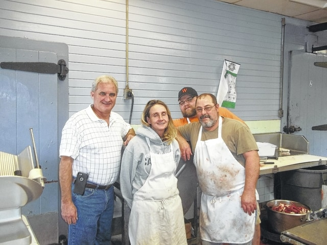 """Lion Mike Cullom helps Jerry Morris, Angel Morris and Shane Smith prepare sausage to be served at the semi-annual """"Pancake & Sausage Supper"""" on Nov. 14."""