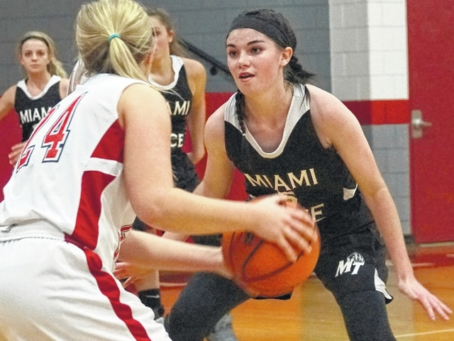 Miami Trace junior Hanna Reisinger, at right, guards East Clinton senior Ciarra Cooper during the SCOL opener for both teams Tuesday, Nov. 24, 2015. Reisinger was the game's leading scorer with 16 points in a 57-26 Miami Trace victory.