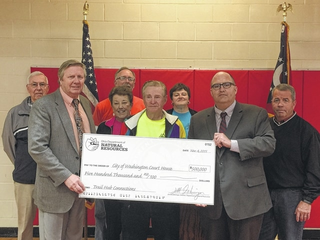 Ohio Department of Natural Resources Director James Zehringer presented a $500,000 check for the Fayette County Triangle Trail on Wednesday morning. The Triangle Trail received the extremely competitive $500,000 Clean Ohio grant so that they can create a trail connection the City to the Triangle Trail in order to make it safer to travel by bike or foot.