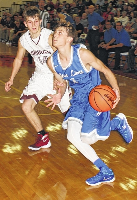 Washington Blue Lion senior Max Knisley drives past Vinton County junior Tristan Bartoe during the third quarter of a non-league game at Zane Trace High School Friday, Nov. 27, 2015. The game was part of the annual Zane Trace Tip-Off Classic.