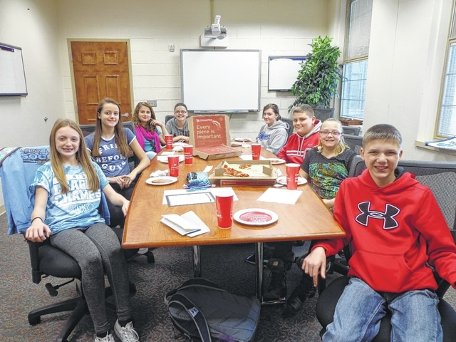 "Donatos recently provided pizza to these students at Washington Middle School as they celebrated ""Pizza with the Principals."" This is in appreciation for their selection as Students of the Month for November. They are chosen by their teachers because of the outstanding example they set for their peers in such areas as academic effort, good work ethic, kindness to others, and service to their school. Pictured from left: Garren Walker, Brittney Wilson, Emily Owens, Madi Zickafoose, Payton Maddux, Jacob Robinson, Tessa Mock and Hayden Sever."