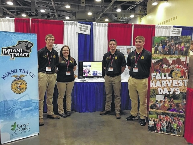 From left to right, FFA members Zach Ault, Hannah Ellenberger, Kameron Rinehart and Cole Karnes, representing Miami Trace FFA at the OSBA Student Achievement Fair presenting their Fall Harvest Day program.