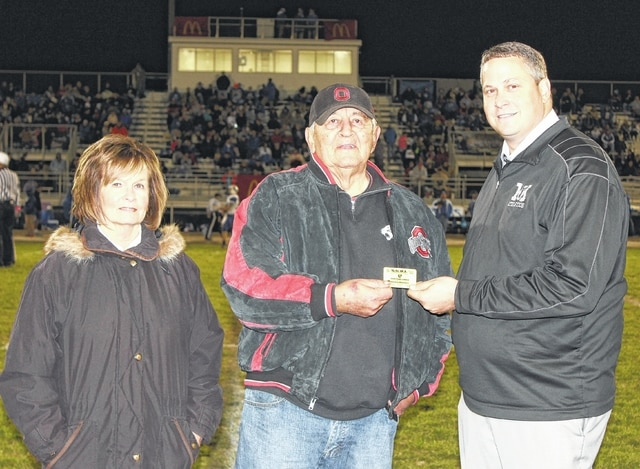 The Miami Trace Panthers recognized Sonny Walters during halftime of the Miami Trace-Washington game Friday, Oct. 30, 2015. Walters received a lifetime pass to all Miami Trace sporting events as a small token of appreciation for over 50 years of service to Miami Trace as an employee, coach and mentor to its students — athletes and non-athletes alike. The award was given to Walters by the Miami Trace Athletic Department. Above, Walters is flanked by his wife, Bev and Miami Trace High School Athletic Director Aaron Hammond.