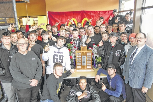 Steve Bartlett (front left) and his Miami Trace varsity football team were presented with the McDonald's Fayette County Championship trophy on Saturday morning at the Jeffersonville McDonald's. Miami Trace won the trophy with their victory over the Washington C.H. Blue Lions on Friday night. Fayette County McDonald's franchise owner Nick Epifano (front right) presented the trophy to the Panthers.