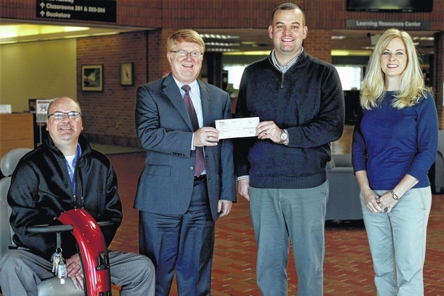 Cam Marsh (center right), U.S. Bank Manager, presents a donation for the SSCC Foundation to Dr. Kevin Boys (center left), President of Southern State Community College, with Matt Roberts (left), U.S. Bank Sales and Service Manager, and Dr. Nicole Roades (right), Vice President of Institutional Advancement for SSCC. U.S. Bank has been a significant contributor to Southern State, exceeding $16,000 in donations and resulting in numerous scholarships to Southern State students. The SSCC Foundation exists to support the needs of Southern State and its students through scholarships, capital improvements, and financial support for academic program development and enhancement. To learn more, please visit www.sscc.edu/about/foundation.shtml.