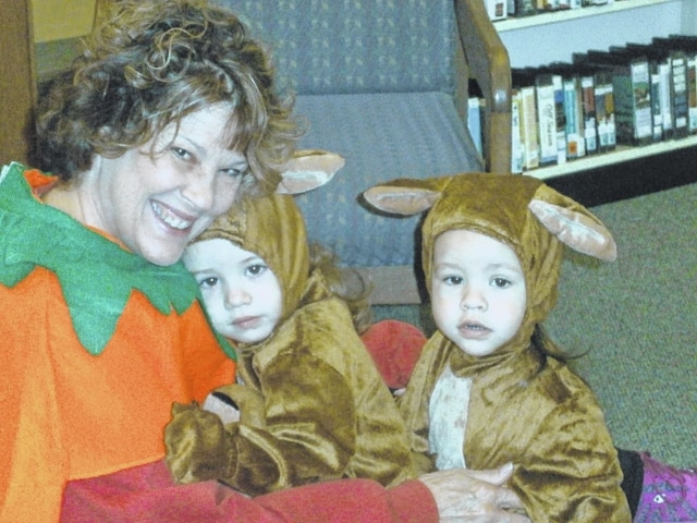 """Jeffersonville Branch Library was the place to be for the """"Toddlers on Parade"""" during Miss Bonnie's Story Hour recently. Grandma GG (Cindy Grover) is shown here posing with her two adorable granddaughters, Addie and Ellia while dressed in costume for the event."""