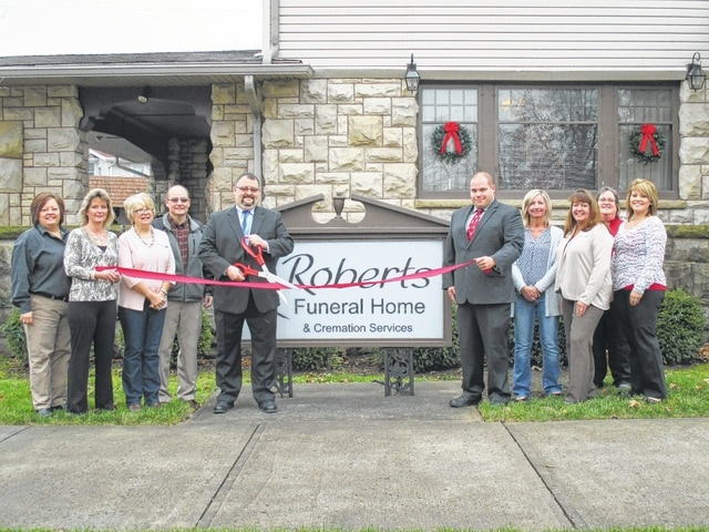 The Fayette County Chamber of Commerce welcomed Roberts Funeral Home to the community with a ribbon cutting on Friday morning. The community is invited to attend its open house today from 3 p.m. until 7 p.m. to tour the facility, see the renovated chapel, enjoy cookies and cider and have a chance to win door prizes.