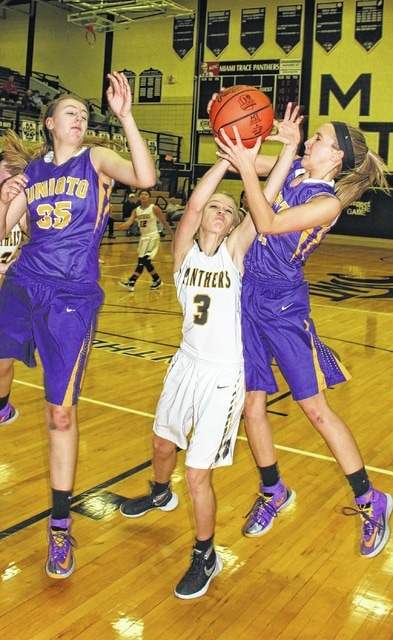 Miami Trace freshman Cassidy Lovett (3) fights for a rebound during a non-league game against Unioto Saturday, Dec. 19, 2015. One of the players pictured for Unioto is sophomore Caroline Thiel (35).