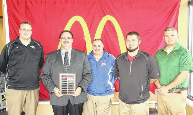 The annual McDonald's Holiday Basketball Tournament is right around the corner. On Monday, Dec. 14, athletic directors from the four participating schools met with McDonald's of Fayette County and Jamestown owner and operator Nick Epifano, to finalize plans for the upcoming event. (l-r); Aaron Hammond, Miami Trace; Nick Epifano; Mark Rinehart, Greeneview; Jim Wolverton, London and Matt Mason, Madison Plains.