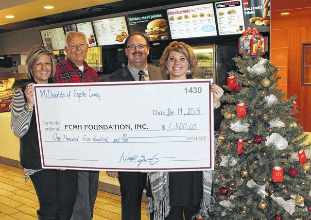 From left to right: Shara Evans, FCMH Marketing/Foundation Coordinator; Roger Kirkpatrick, FCMH Foundation board member; Nick Epifano, owner of Fayette County McDonald's; and Chelsie Hornsby, FCMH director of business development.