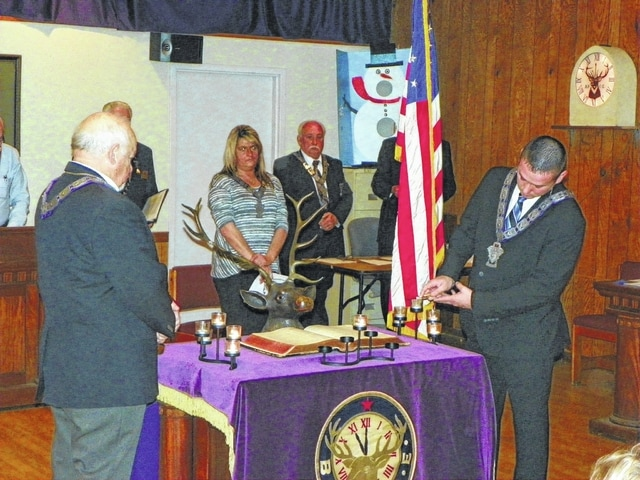 The Elks Lodge No. 129 held the mandated Memorial Service on Sunday at its lodge to honor the members who passed away this past year. Between Dec. 7, 2014 and Dec. 6 of this year, 11 members of the Elks Lodge passed away. Past exalted ruler Larry Cruea, at left, and loyal knight Tyler Osborne, at right, extinguished 11 candles to symbolize the members being honored passing away.