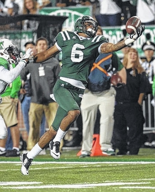 Ohio University junior Sebastian Smith (6) stretches to make a one-handed catch for the Bobcats during a game against Marshall on Sept. 12, 2015. Ohio won this game, 21-10. Smith was recently named Third Team, All-Mid-American Conference for 2015.