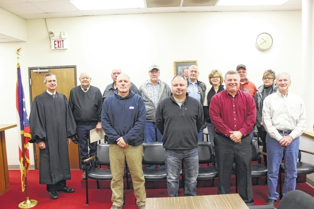 Judge Victor Pontious swore in several local officials Thursday morning at the Washington Municipal Court. Pictured (L to R): front row: Keith Montgomery, Myron Miller, David Dorn and Thomas Rambo. Back row: Judge Pontious, Richard Barton, Duane Matthews, Richard Wilson, Howard Smith, Bridgett Sollars, Chris Wright and Jomi Ward.