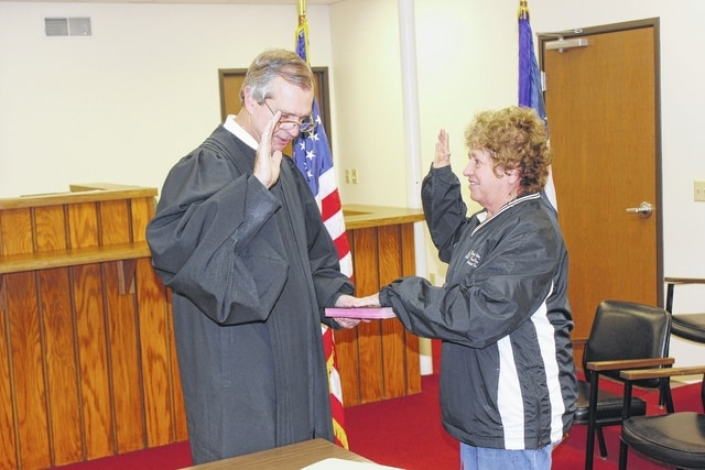 On Thursday, 18 village officials were sworn into office by Washington C.H. Municipal Court Judge Victor Pontious. Sue Burnside was sworn in to serve her new term on the Jeffersonville Village Council.