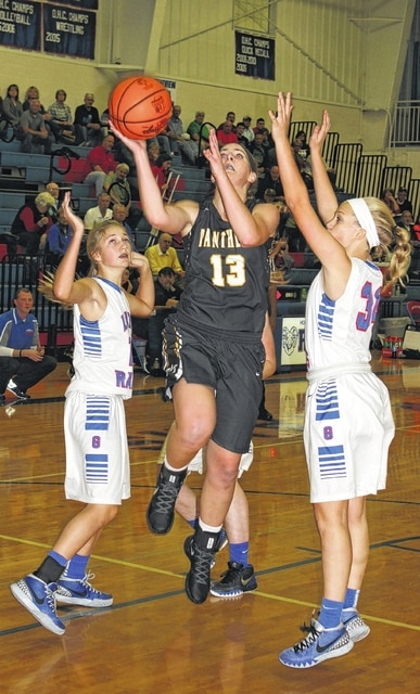 Miami Trace sophomore Victoria Fliehman (13) drives between two defenders for Greeneview in the championship game of the McDonald's Holiday Tournament Wednesday, Dec. 23, 2015 at Greeneview High School. Fliehman made her Miami Trace debut Wednesday, with four points, three rebounds, two assists and one steal, which came at the very end of the game as Greeneview was inbounding the ball in a thrilling 34-33 Lady Panthers' victory.