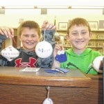 Kids craft Christmas creations at Jeff Library