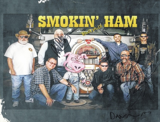 "The Fayette County Agricultural Society recently released a list of events for 2016, which includes the Smokin' Ham Band performing on Feb. 6 at the Mahan Building. The Smokin' Ham Band is pictured with their pig Oscar, the ""Smokin' Ham"" of the group. The pig is a great mascot and attends all of the events, blowing smoke for the crowd to enjoy."