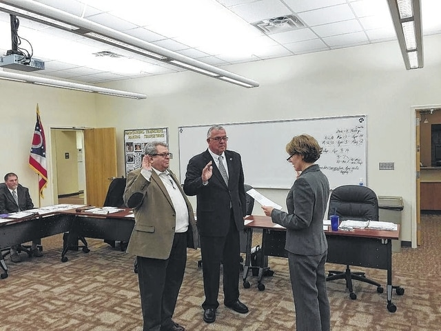 Bruce Kirkpatrick and Charlie Andrews were sworn in for another term as Miami Trace Board of Education members by Treasurer Debbie Black at Tuesday's organizational meeting.