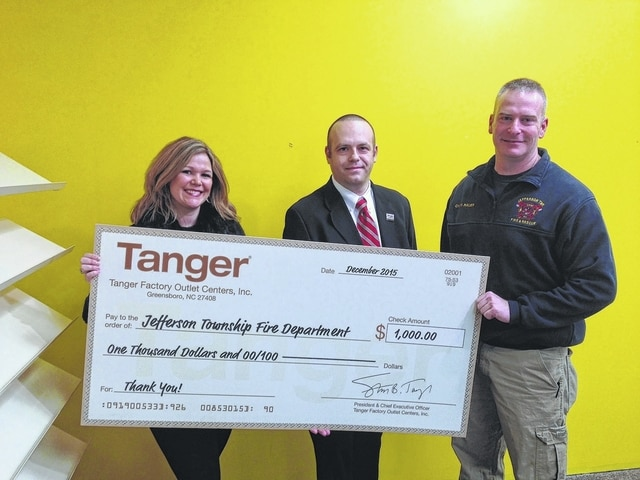 Tanger Outlets recently donated to the Jefferson Township Fire Department. From left to right, Kristen Hauer, Tanger Outlets general manager, Andy Gibson, Tanger Outlets AGM, and Aaron Hauer, the Jefferson Township Fire Chief.