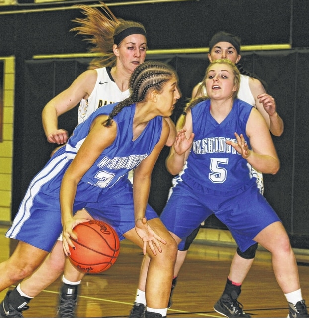 Washington freshman Hannah Haithcock (with ball) is guarded by Miami Trace sophomore Victoria Fliehman while Washington senior Jaycie McRoberts (5) looks for the ball, guarded by Miami Trace junior Hanna Reisinger during an SCOL game at Miami Trace High School Saturday, Jan. 2, 2016.