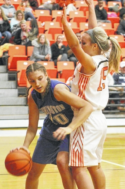 Washington freshman Hannah Haithcock works to get around Wilmington's Suzanna Johns during an SCOL game at Wilmington Wednesday, Jan. 6, 2016.