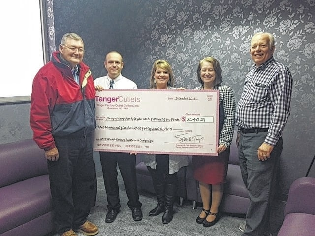 The Fayette County Memorial Hospital (FCMH) Foundation recently received a check from Tanger Outlets in Jeffersonville to help support the hospital. Pictured left to right: Ron Ratliff, FCMH Foundation Board Member, Andy Gibson, Tanger Outlets Jeffersonville Assistant Manager, Chelsie Hornsby, FCMH Director of Business Development, Jane Bissel, FCMH CFO and Roger Kirkpatrick, FCMH Foundation Board Member.
