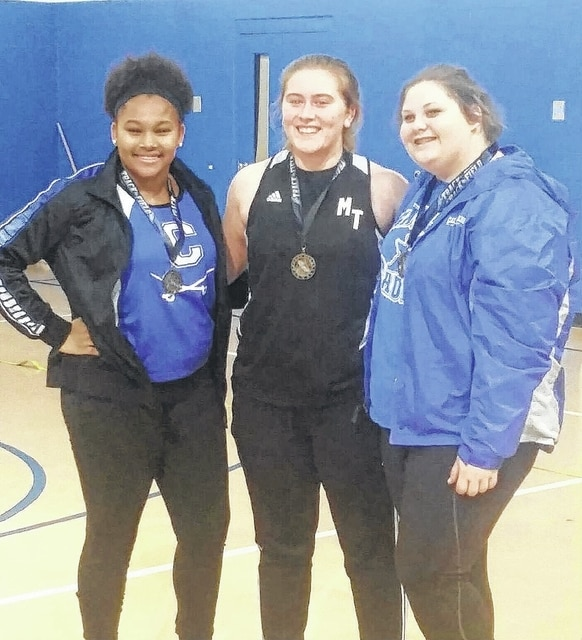 """Miami Trace's Katie Seyfang, above, center, began the indoor track and field season by winning the shot put competition at Chillicothe on Jan. 8, 2016. Seyfang's winning throw was 31' 10"""". Pictured at left for Chillicothe is Janai Summers."""