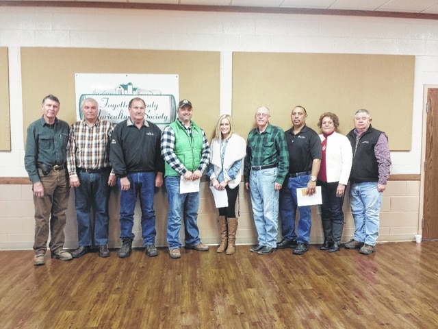 The Fayette County Agricultural Society released the sponsor list for the upcoming performance of the Smokin' Ham Band at the Mahan Building on Saturday, Feb. 6 from 7:30 to 11 p.m. Pictured (L to R): Wayne Arnold with senior fair board director, Danny Preston with Buckeye Propane, Dennis Garringer with Crop Production Services, Doug Coe with Gustin Seed Services, Morgan Pentzer with Lewis & Langley Realty, Rob Burke senior fair board member, Steve Cole with The Willow Catering, Faith Cottrill, fair board secretary and Robert Schwartz fair board president.