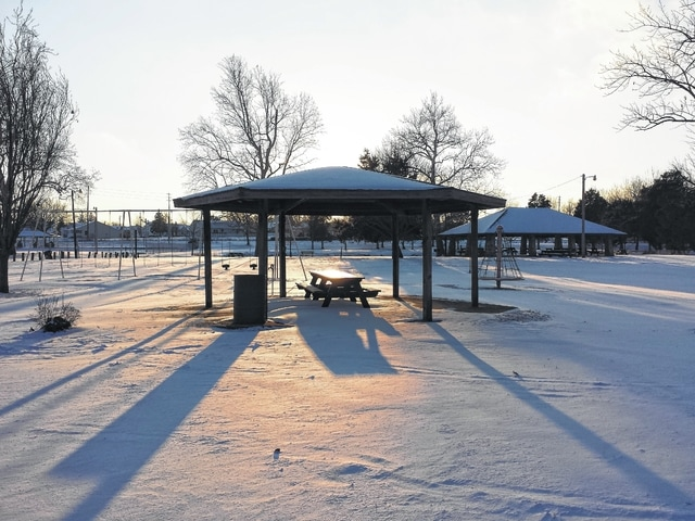 Fayette County has continued to receive snowfall for a couple of days with accumulation of several inches in places. The Washington Park Gazebo and Eyman Park were empty as the wind whipped and howled throughout the day.
