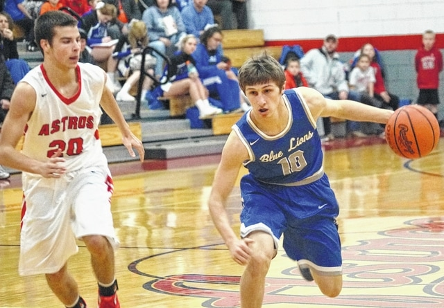 Washington Blue Lion senior C.J. Taylor (right) has the ball during an SCOL game at East Clinton High School Tuesday, Jan. 19, 2016. Pictured for East Clinton is Wyatt Floyd.