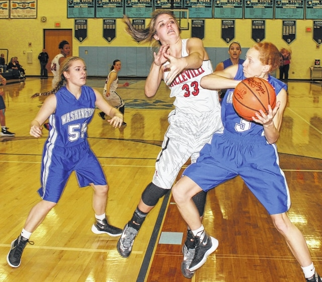 Washington senior Alexis Gray, at right, keeps the ball from being swatted away by Circleville's Jordin Blakeman during a Division II Sectional final game at Adena High School Saturday, Feb. 13, 2016. Also pictured for Washington is Taylor Smith.