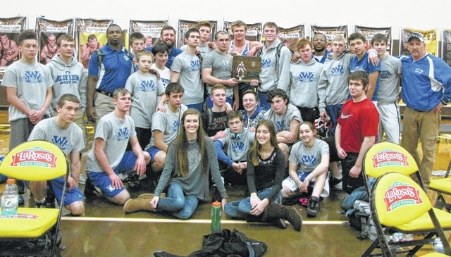 The Washington Blue Lion wrestling team is pictured after splitting matches with Miami Trace and Western Brown Wednesday, Feb. 3, 2016 in the dual meet team tournament at Western Brown H.S. Washington beat the Panthers, but lost in the finals to Western Brown. They are Regional runners-up, the farthest a Blue Lion team has gone yet in this tournament. (front, l-r); Kenzie Osborne and Jerrica Hites, statisticians; (second row, l-r); Caden Smith, Jay Fettig, Eli Shaw, Ethan Stewart, Connor Chrisman, Alan Bailey, Sam Willis (videographer), Courtney Walker, Haden Willet; (back, l-r); Tre Thomas, Levi Clay, coach Marlin Ellis, Chris Martin, Devin Slagle, Connor Lane, coach Ryan Wells, Jerry Knapp, Zane Wilson, Steven Willis, Trevor Hicks, Mason McCane (Willis and McCane are holding the Regional runner-up trophy); Austin Hixon, head coach Louis Reid, Collin George, Zane Nelson, Chris Conger and coach Roger Wilson.